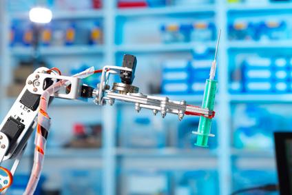Robot holding a medical syringe