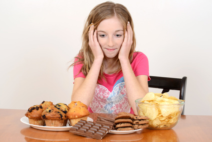 Child with huge pile of junk food