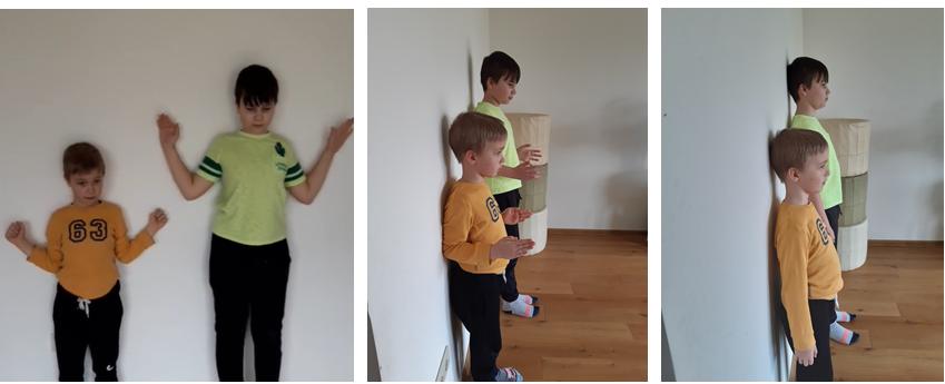 Vaikai prie sienos atlieka pratimą